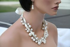 Beautiful off white glass pearls and off white ribbon together with strands of silver chain looks elegant at an affordable price. Do not let the price think that this is not quality ..It is both beautiful and quality.. I have seen these same ones on etsy sell for over 100 dollars.