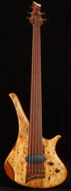 ArtMarleaux Diva 5-String by Marleaux Bass Guitars - woody, curvy and sporting an interesting P/U. Bassists do get to play with the fruitiest body shapes.