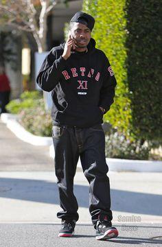 NaS wearing Air Jordan IV Bred