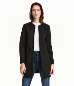 Black. Short coat in texture-woven fabric. Open at front with long sleeves and patch pockets. Lined.