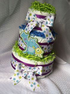 Baby Shower Decorations: Diaper Cake – Baby Girl or Boy – Monsters Inc. – B… - Top Trends Baby Shower Diapers, Baby Shower Cakes, Baby Boy Shower, Diaper Shower, Monsters Inc Baby Shower, Monster Baby Showers, Baby Shower Decorations For Boys, Baby Shower Centerpieces, Disney Diaper Cake