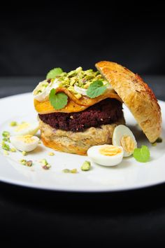 Sophisticated yet easy beet falafel burger with baba ganoush, cardamom roasted butternut squash, chèvre and pistachios, served with a homemade rosemary bun. Falafel Burgers, Salmon Burgers, Sandwich Day, Baba Ganoush, Roasted Butternut Squash, Beets, Main Dishes, Clean Eating, Berries
