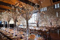 wedding reception with farm tables. -photo taken by Ira Lippke