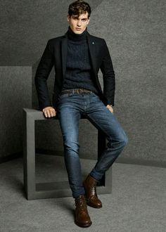 Shop this look on Lookastic: http://lookastic.com/men/looks/turtleneck-blazer-belt-jeans-boots/6091 — Navy Turtleneck — Black Wool Blazer — Dark Brown Leather Belt — Navy Jeans — Brown Leather Boots