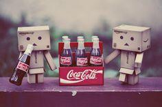 Box guy(& gal) drinking coke
