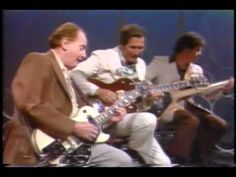 Les Paul and Chet Atkins - Limehouse Blues / Chet's folding guitar - YouTube.  Two of the best guitarists ever!