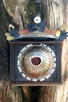 Creator of this bird house states it's made from an old clock missing it's face.  Some more details given, but study the picture closely and you can see the other building details.