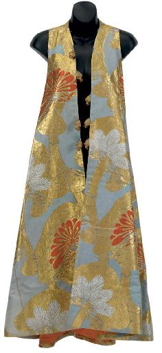 japonismefashion:  Sleeveless Evening CoatChristian Dior1978A Christian Dior blue-grey, orange and gilt-brocade sleeveless long evening coat. Tunic style, made from obi fabric featuring an allover pine-leaf pattern.