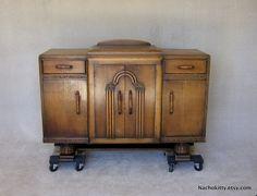 Reserved for Transcendingworks: Art Deco Sideboard Storage Cabinet 1920s English Footed Furniture. $545.00, via Etsy.