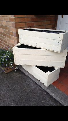 Hand built solid wooden planters, made from reclaimed pallet timber