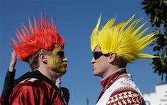 Florida fans Drew Meyer, left, and Trevor Caldwell from Tampa, cheer for the arrival of the Florida State players before the Rose Bowl NCAA college football playoff semifinal game between Florida State and Oregon, Thursday, Jan. 1, 2015 in Pasadena, Calif. (AP Photo/Jae C. Hong)
