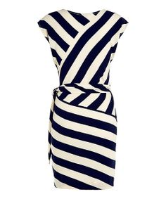 London-based Louche makes pieces with style to spare. This dress shows off a striking stripe print with a chic twist-front design that's sure to be cocktail-party dynamite. Size note: This item runs in UK sizes. Please refer to the size chart.