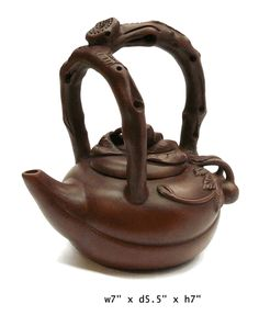 """Chinese Zisha Clay Peach Theme Teapot Display    This is a modern style Zisha clay teapot with new shape and color glaze. ( for collection or display purpose only )    Dimensions: w7"""" x d5.5"""" x h7""""  Origin: China  Material: Zisha  Condition: Hand made, not perfect"""