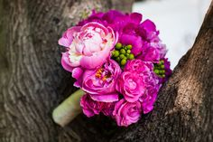 Vibrant #bridal bouquet with #fuchsia #peonies, spray #roses and #hypericum. Design by teresaferrando.com. Ruby Star Photography.