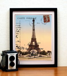 An archival print of an original collage by piddix, made with layers and layers of ephemera including an image of the Eiffel Tower from the 1889s (the year the Eiffel Tower was built). This same image is featured on journals at Target. full-time-etsy-crafters