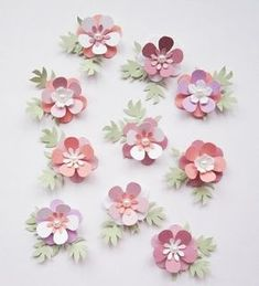 Paper flowers - cute embellies from punched flowers, stacked for dimension - add a pearl or jewel center. Paper Flowers Craft, Felt Flowers, Flower Crafts, Diy Flowers, Fabric Flowers, Paper Crafts, Diy Crafts, Pretty Flowers, Fleurs Diy