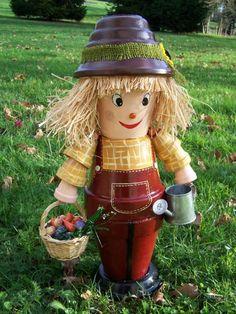 personnages en pots de terre cuite