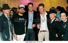 Britain's Princes William (3rd L) and Harry pose with members of pop band Orson at a backstage party after the Concert for Diana at Wembley Stadium in London July 1, 2007.  An international lineup of pop stars paid tribute to Princess Diana on Sunday at a memorial concert watched by her sons Princes William and Harry and a crowd of 60,000 at London's Wembley Stadium.  Picture taken July 1, 2007.   REUTERS/Carl de Souza/Pool   (BRITAIN) - Stock Image