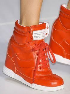 Bright orange wedge sneakers