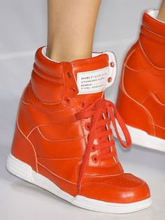 Bright orange wedge sneakers