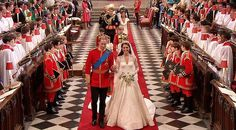In this image taken from video, Britain's Prince William, left, and his wife, Kate, the Dutchess of Cambridge, walk down the aisle together at Westminster Abbey for the Royal Wedding in London on Friday, April, 29, 2011.