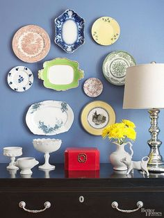 Hit a home run with every display by using paper templates and a pencil to mark the perfect arrangement before adhering the heirloom dishes with wall hangers.