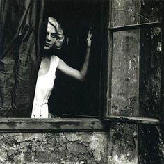 Woman at the Window, Vienna, 1933. By Bill Brandt