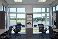 Johnston Regional Airport  LEAD DESIGNER ROB MACNEILL, Allied ASID  CONTRIBUTING DESIGNERS JUDY PICKETT, FASID  ADDITIONAL CREDITS GENERAL CONTRACTOR: DANIELS & DANIELS CONSTRUCTION  ARCHITECT: MBAJ/BOOMERANG DESIGN  JOHNSTON COUNTY AIRPORT COMMISSION  PHOTOGRAPHY BY: DUSTIN PECK PHOTOGRAPHY