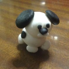 How to make a dog figure from fondant via @Guidecentral - Visit www.guidecentr.al for more #DIY #tutorials