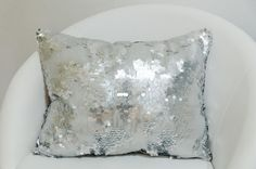 Decorative pillow case with silver metal shells. by ThePillowWorld