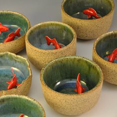 koi clay bowl ceramics project: could be a pitch pot cup with an animal of your choice inside. like the cups with surprise frog at bottom, revealed when you drink all your milk.