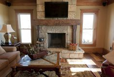 fire places using barn beams | Old Growth Flooring Hand-Hewn Timbers Antique Barn Siding Fireplace ...