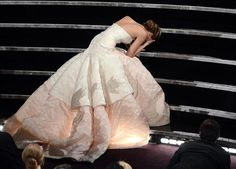 """2013 Oscars - poor Jennifer Lawrence falls on the stairs from her enormous Dior gown while going to accept her Oscar for Best Actress in """"Silver Lining's Playbook"""""""