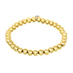 Chic large 6mm high shine 14k gold plated beads strung on a strong elastic stretch bracelet. One size fits all. Meant to be layered with other Gold or Silver beaded bracelets.