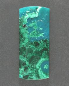 Gorgeous, deep blue gem Chrysocolla with chatoyant green malachite plumes and sprays in chalcedony, deep aqua blue and chatoyant green in this dramatic designer cabochon. All natural material mined back in the 1950's in Arizonas Miami/Globe region. This stone measures 34x14 mm and is 4 mm thick, the weight is 31.5 cts.  $410.00