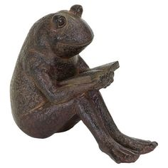 """Weathered reading frog garden statue.  Product: StatueConstruction Material: PolystoneColor: BrownDimensions: 7"""" H x 8"""" W x 4"""" D"""