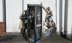 Possible Banksy work near GCHQ shows agents tapping into phone box