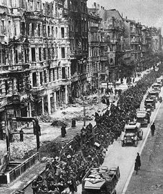 German POW's being marched down the streets of war torn Berlin