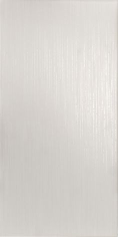 Isis Linear Tile ' A sparkling white linear tile from the Eden Collection by Louisa Charlotte. Create a bright and fresh atmosphere for your chosen room with the Isis Linear Tile; watch as the light glistens across the textured linear surface displaying a subtle twinkling effect.'