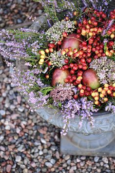 Autumn planter with heather, apples and cranberries