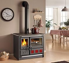 """Wood Burning Cook Stove La Nordica """"Rosa XXL"""", with Baking Oven Wood burning cook stove, cooking range Cast iron cooktop, wood drawer Frame, plate and rings in cast-iron Very large baking oven Efficient Combustion System Wood Burning Cook Stove, Wood Stove Cooking, Pellet Stove, Oven Design, Küchen Design, Cooking Appliances, Home Appliances, Modern Ovens, Stove Fireplace"""
