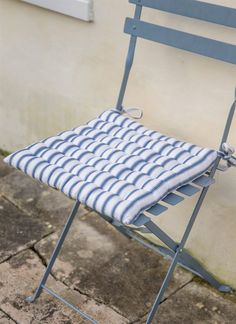 Available in Clay or Blue Stripe, these Seat Pads add even more style and comfort to your garden chairs