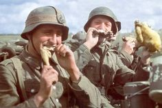 Wehrmacht soldiers eating roast chicken outside of Stalingrad, 1942 - pin by Paolo Marzioli