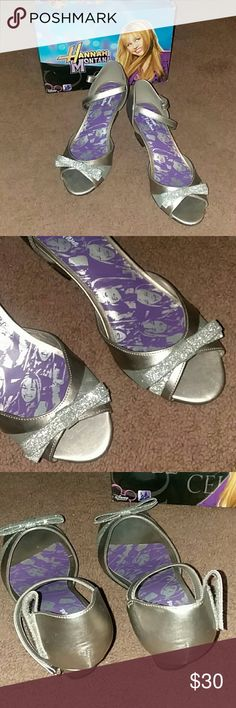 Brand new Disney Hannah Montana pumps Beautiful silver sparkled pumps!!! Never been worn!!! Strap has a velcro closure, open toed with an adorable glittery bow!!!! Comes with original box!!!! These are great first dance pumps!!! Also great for a princess Halloween costume!!!!!  Says size 4.5..... I don't know if it's a womens 4.5 or girls 4.5!!!! I would assume a childs size but they fit me!!!! Disney Shoes Dress Shoes
