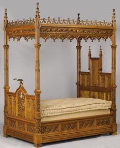 AN ENGLISH GOTHIC REVIVAL OAK TESTER BED. Late 19th Century.