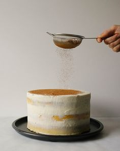 This tiramisu cake is 3 layers of vanilla cake soaked with coffee and liquor filled with a mascarpone cream cheese and coffee liquor frosting.