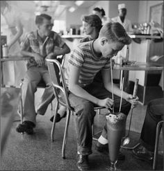 """Milkshakes, 1953Image by © Genevieve Naylor  """"In the 1950s, milkshakes were called """"frappes"""", """"velvet's,"""" """"frosted drinks"""", or """"cabinets"""" in different parts of the US. A specialty style of milkshake, the """"concrete"""" was …a milk shake so thick that the server hands it out the order window upside down, demonstrating that not a drop will drip.""""  Railroad Jack"""