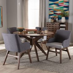 The Montreal Mid-Century Dining Set is ideal to gives your dining room a quick and elegant makeover. This dining set furniture includes a dining table constructed of solid rubberwood and six grey faux leather upholstered dining chairs. Dining Furniture Sets, Dining Room Sets, Dining Room Table, Dining Chairs, Rattan Chairs, Bag Chairs, Wood Table, Round Dining Table Modern, Round Table And Chairs