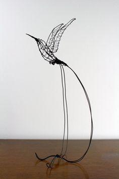 A wire hummingbird sculpture makes a bird-lover's heart sing. #etsy #etsyfinds