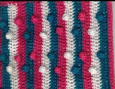 """Colorful Bobble Washcloth - Designer's Note: This wash cloth was made out of 3 colors of size 8/2 cotton rug warp + a size """"D"""" crochet hook. However, the pattern is adjustable--you could easily substitute Speed Cro-Sheen, or 2 strands of Cotton thread #10. If you like a thicker dishcloth than you can substitute Southmaid Cotton #8, or other cotton sport weight yarn/thread.  Model made by designer, using Maysville Carpet Warp. Finished size is about 10"""" x 10"""""""
